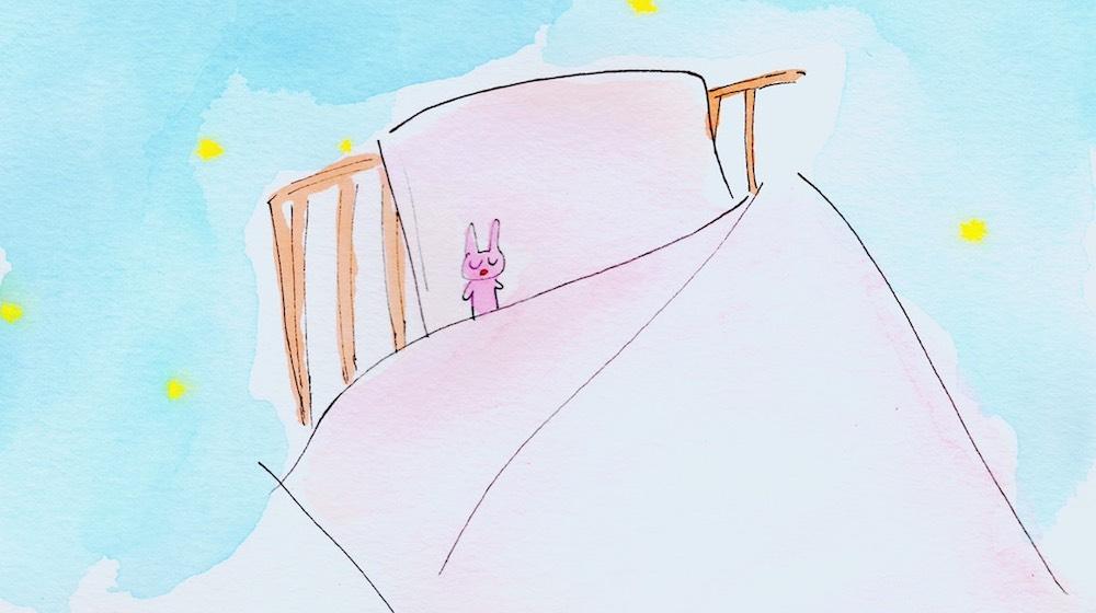 ピンクのベッドカバー